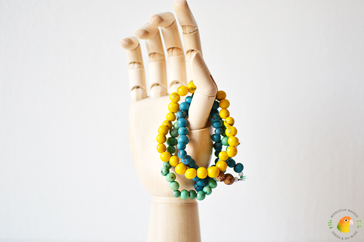 Afbeelding Freedom Beads in houten Hay hand